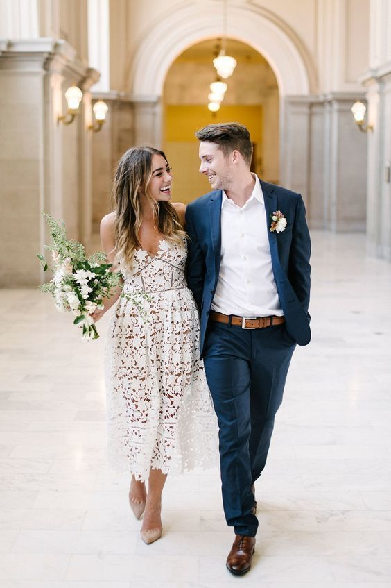 a floral lace off the shoulder midi wedding dress plus nude pumps for a city hall wedding