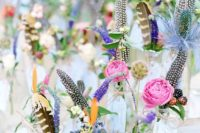 17 cute colorful centerpieces with purple and pink blooms plus berries and feathers