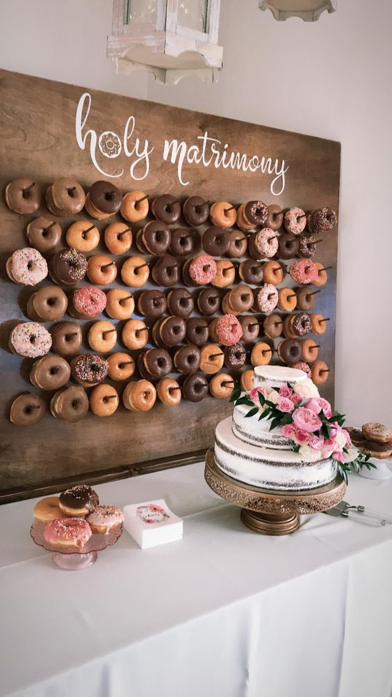 if you are serving donuts, make a trendy donut wall to display them with style