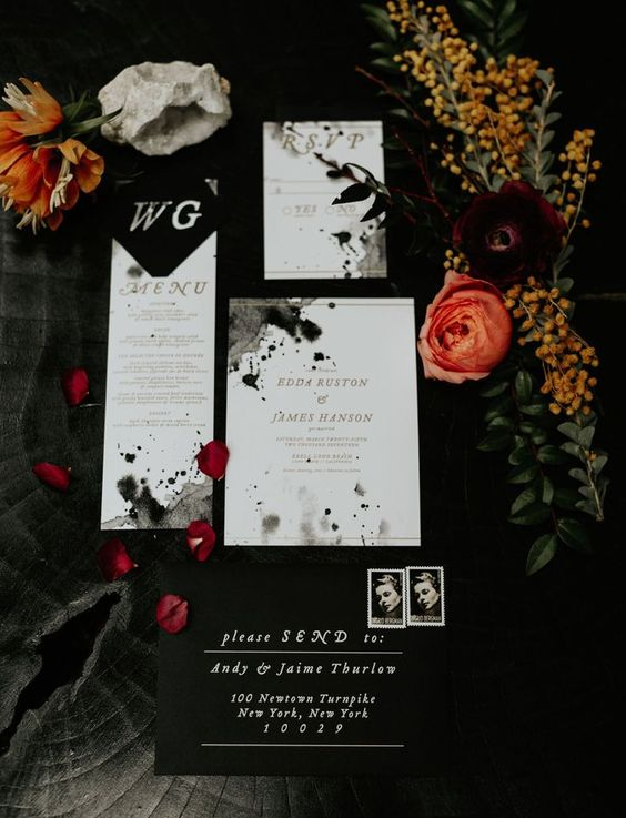 ink splatter modern black and white wedding invitation suite with gold calligraphy for a modern haunted wedding
