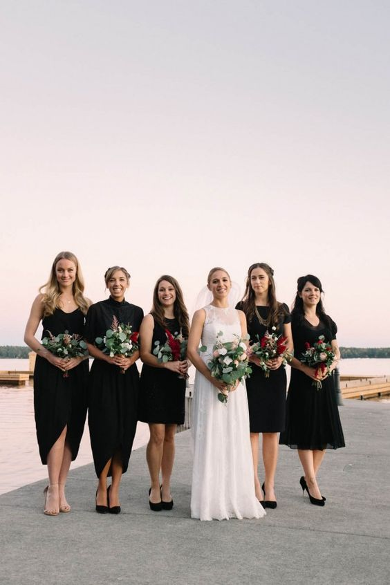 mismatching black bridesmaids' dresses with various necklines, lengths and different shoes