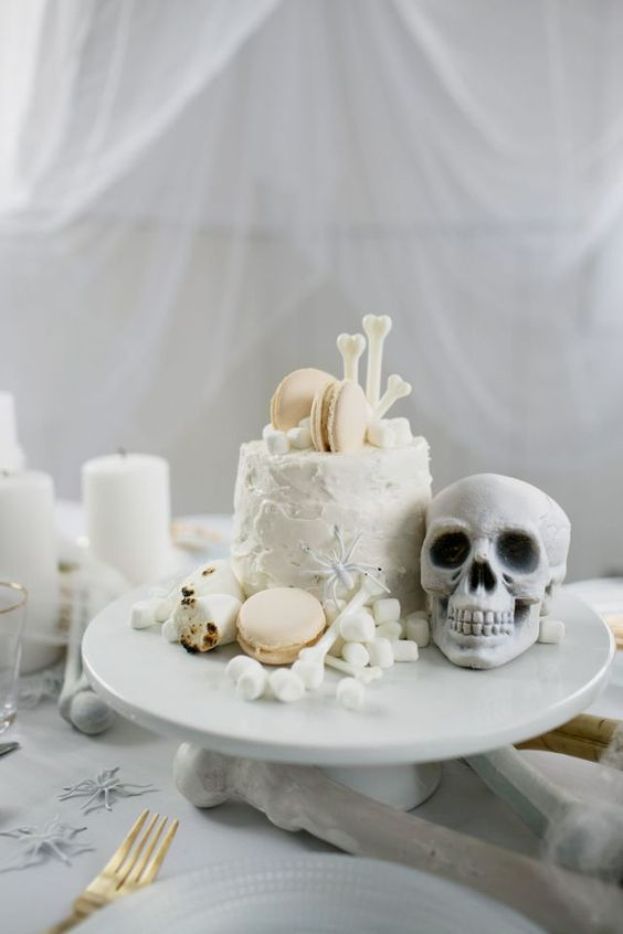 a Halloween wedding cake served with marshmallows, faux bones and skulls