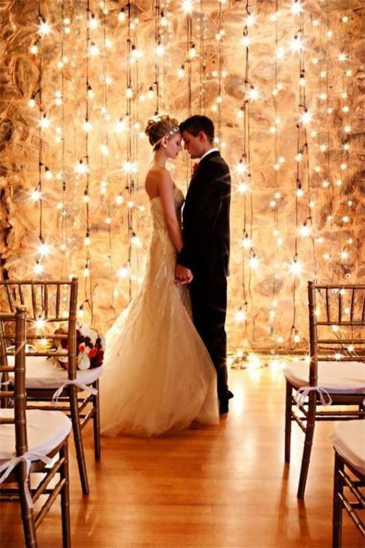 a backdrop made of hanging bulbs is a dreamy idea for any wedding