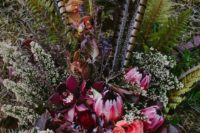 19 a bright wedding bouquet with pink, orange and fuchsia blooms and feathers