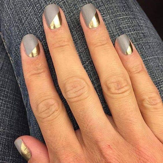 spruce up matte grey nails with a touch of metallic geometric decor to add a shiny detail to your look