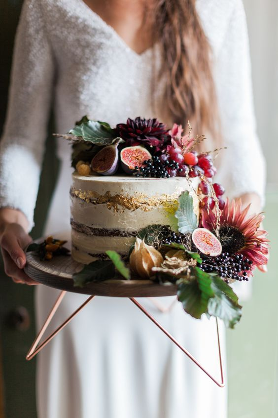 a wood and copper stand is great for a boho fall wedding with a natural touch