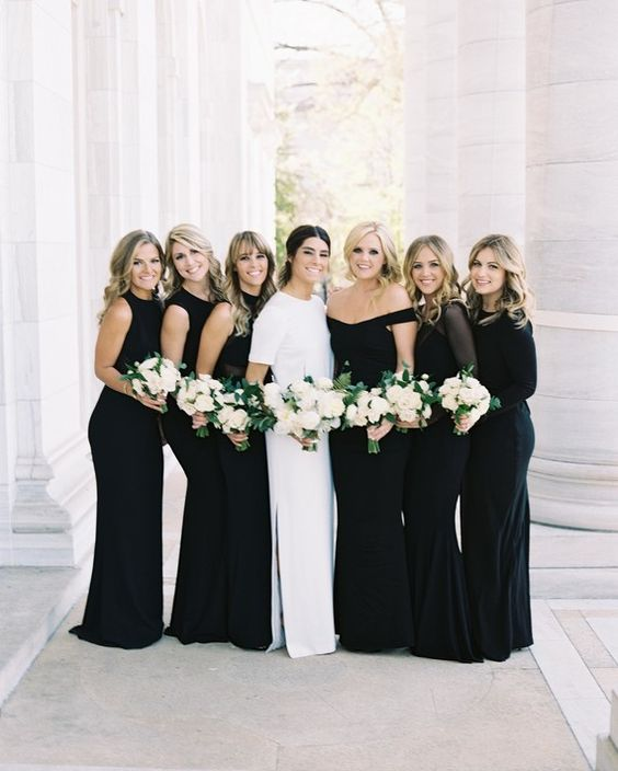 mismatched black mermaid bridesmaids' gowns with various necklines and sleeves