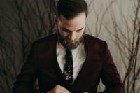 21 a burgundy suit, a white shirt and a dark floral tie for a moody Halloween look