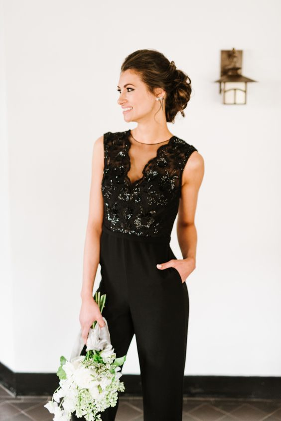 a chic black sleeveless bridesmaid's jumpsuit with an illusion neckline and a shiny bodice for a wow look
