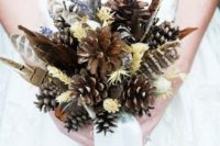 21 a fall boho wedding bouquet with feathers, pinecones, herbs and an airy ribbon