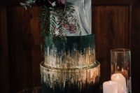 21 a jaw-dropping wedding cake with marble and black layers and much gold foil plus moody blooms