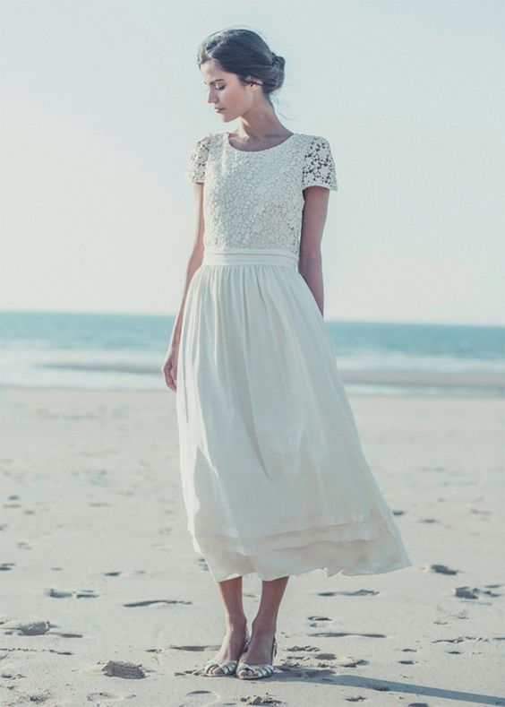 a romantic vintage-inspired wedding dress with a lace applique bodice, short sleeves and a pleated skirt