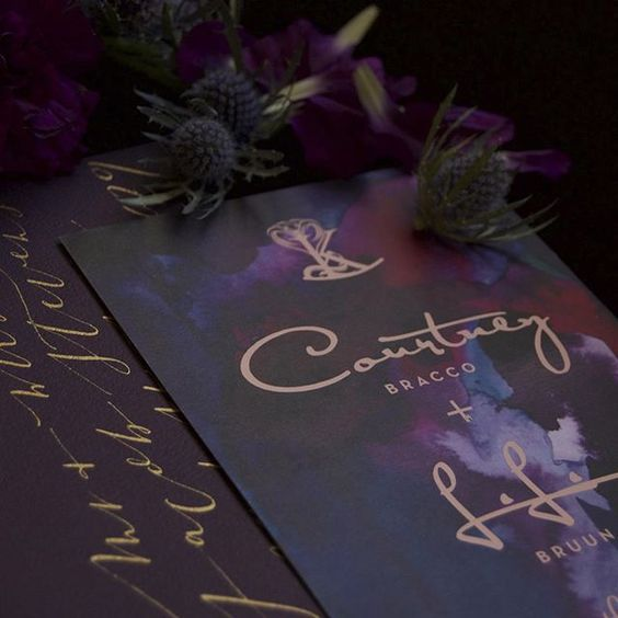 jaw-dropping gradient dark invitations in purple, deep red, black with gold calligraphy