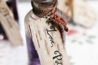 21 love potion bottles filled with grape juice with tags look very cool and magical