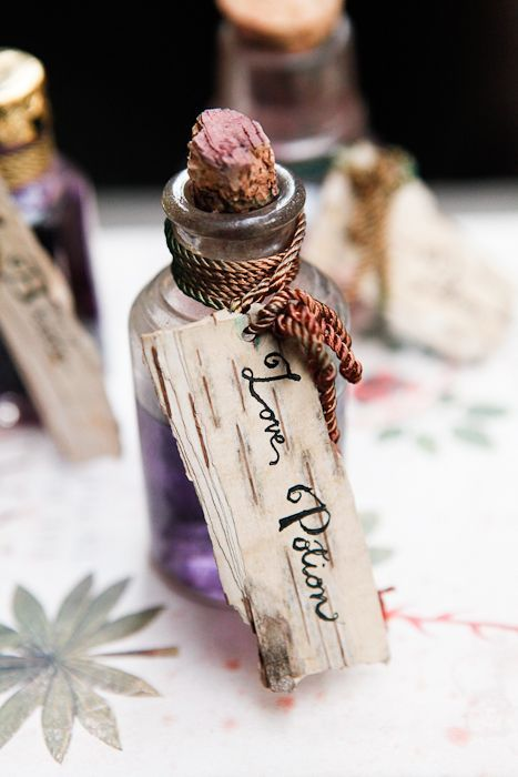 love potion bottles filled with grape juice with tags look very cool and magical
