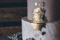 22 a lavender and lavender marble wedding cake decorated with a touch of gold foil