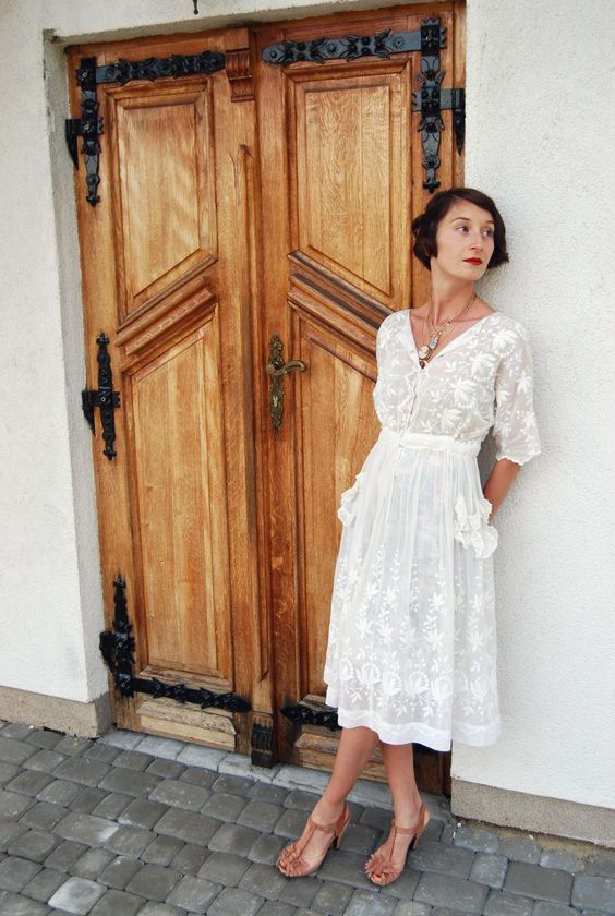 a vintage lace midi dress with long sleeves and appliques plus vintage shoes