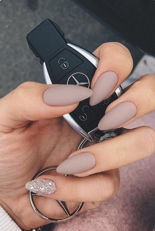 light grey matte manicure with a single statement nail done with rhinestones is a bold idea for a timeless look