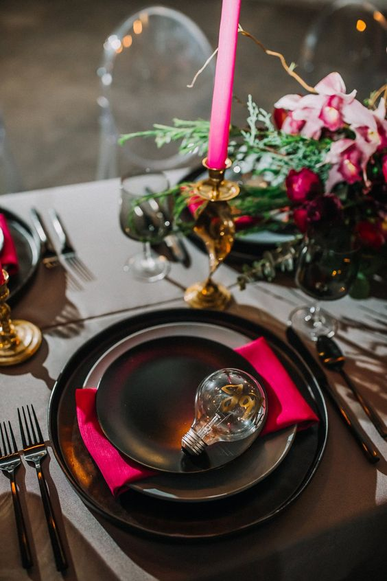a modern and bold wedding table setting with a bulb with calligraphy instead of a place card
