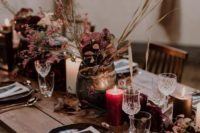 23 a moody wedding tablescape done with burgundy and plum blooms, black candles and chargers