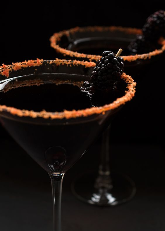 black devil martinis in glasses with food coloring to give them a creepy touch
