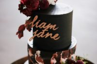 24 a gorgeous wedding cake with a black tier and a textural white and burgundy one plus white and burgundy blooms