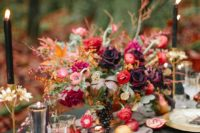 24 a right Halloween wedding centerpiece with fuchsia, burgundy and red blooms and some berries