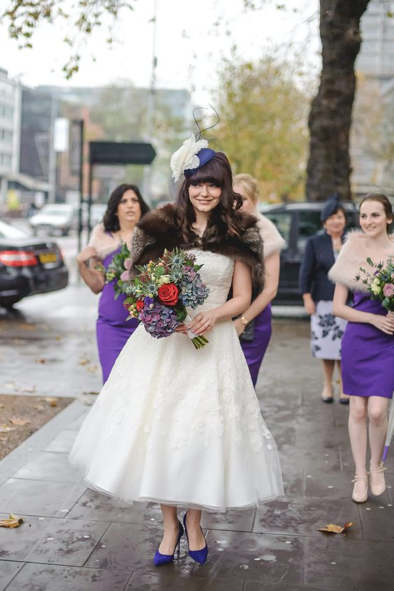 a vintage inspired lace midi A line wedding gown with statement purple shoes