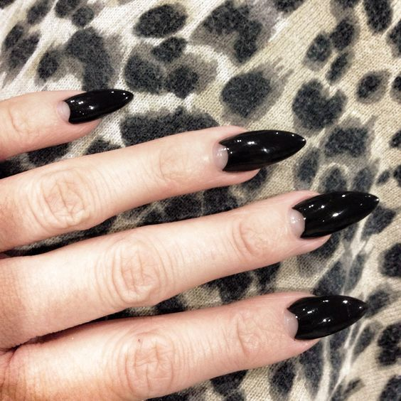 dramatic black sharp half moon nails are a bold and bright idea for a Halloween wedding