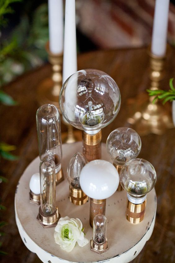 an industrial wedding centerpiece of vintage bulbs and blooms will add enough light to the space