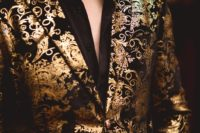 25 black pants, a black shirt and a bold gold and black patterned jacket for a wow effect