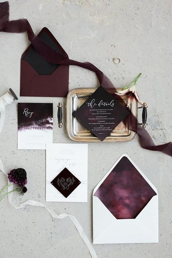 burgundy and white wedding invitation suite with black lining and brushstrokes for a moody Halloween wedding