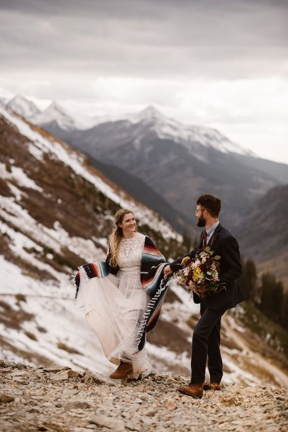 comfy brown boots and a striped folksy coverup for a boho mountain elopement