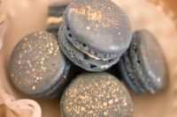 25 grey macarons with some gold foil on top are a nice and glam treat for a wedding