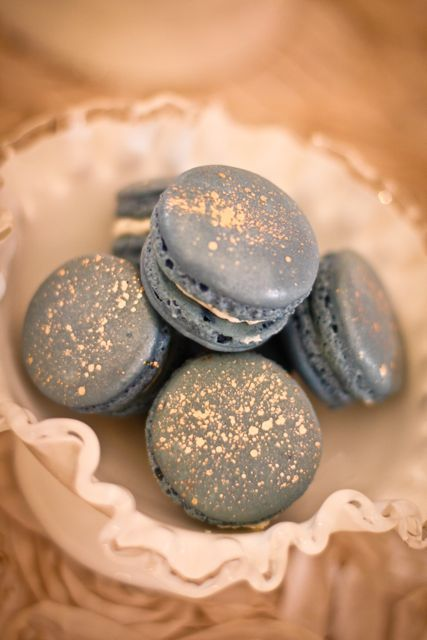 grey macarons with some gold foil on top are a nice and glam treat for a wedding