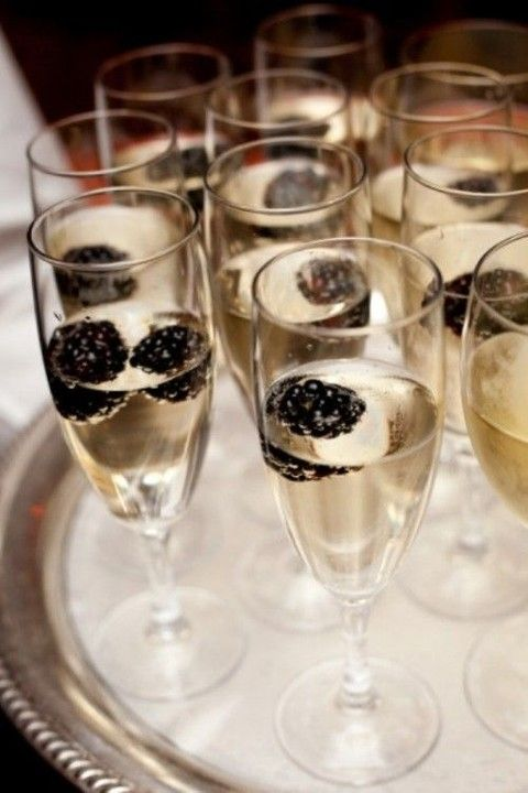 offer your gals champagne with blackberries as an elegant bridal shower drink with a Halloween touch