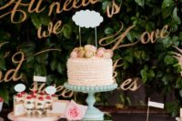 25 the wedding cake is placed on the highest stand to accentuate it as possible
