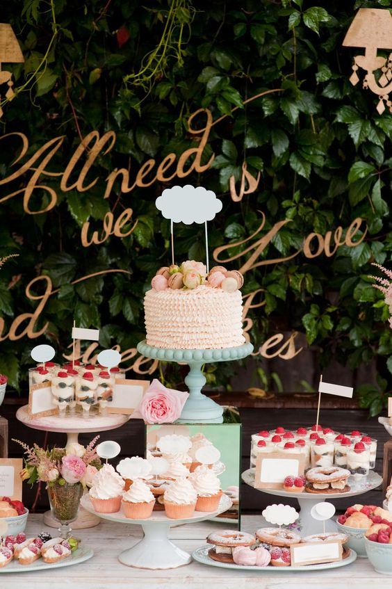 the wedding cake is placed on the highest stand to accentuate it as possible