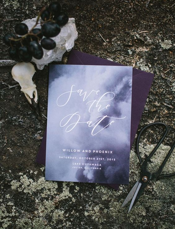 a moody invitation suite with a deep purple envelope and an airy purple and white invite