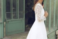 26 a vintage-inspired midi wedding gown with a lace illusion bodice and a plain full skirt, bell sleeves