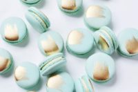 26 mint macarons with touches of gold foil are a tasty and cool-looking dessert