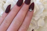 30 sharp matte burgundy nails adorned with bold rhinestones is a stunning idea for a Halloween bride