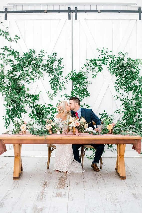 This amazing fall wedding with a fine art feel took place at a white barn and looked very romantic and cool
