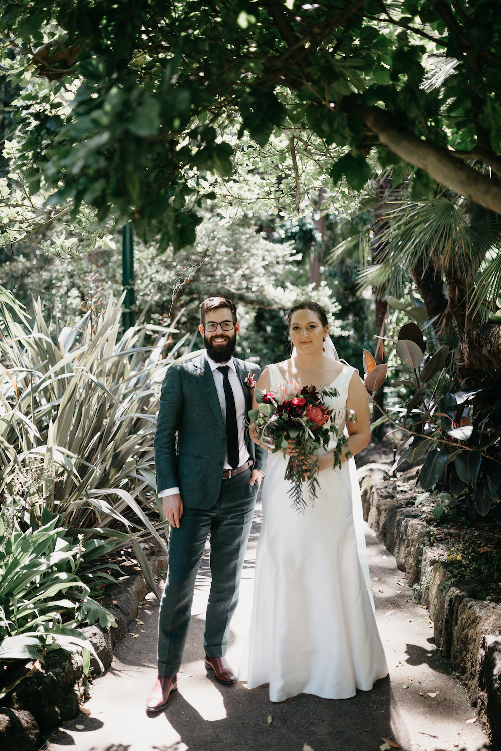 This beautiful couple tied the knot in a greenhouse in Melbourne, and the main themes were greenery and books
