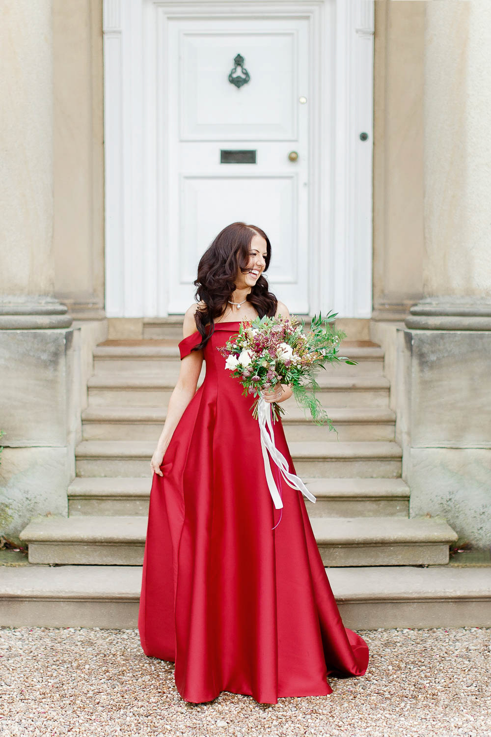 The bride chose a fantastic red off the shoulder A line wedding dress that made a statement