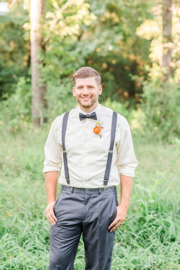 The groom was wearing a relaxed vintage look with grey pants, suspenders and an ivory shirt