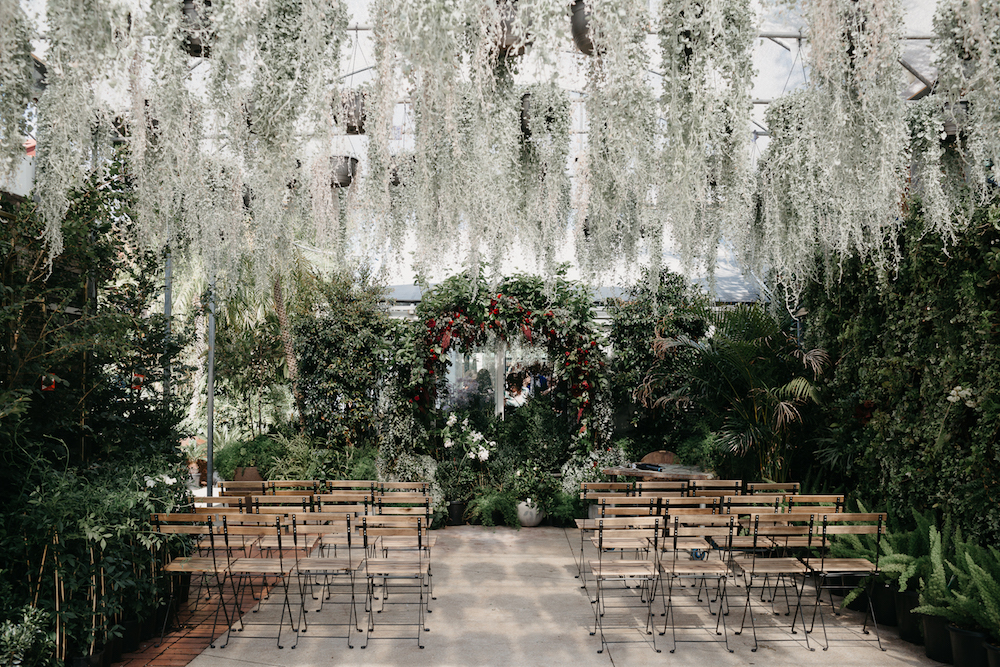 wedding ceremony covered with greenery