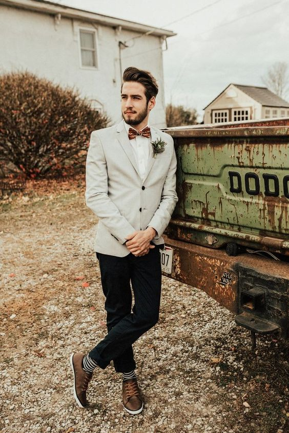 a more casual and creative look is spruced up with a bow tie and is great for a modern playful wedding