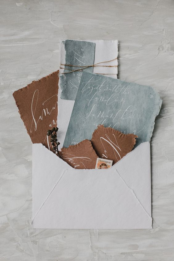 chic pale blue and rust fall wedding stationery with a deckle edge for a refined touch