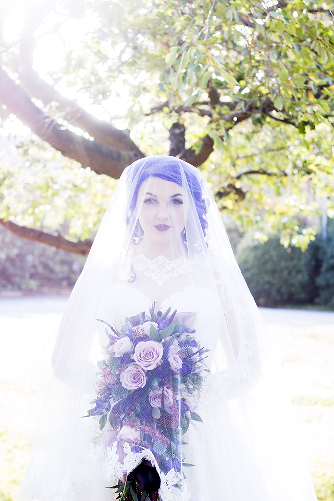 She rocked a veil, a bold lip and amazing purple hair for a statement